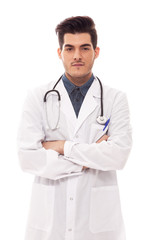 Male doctor is standing with crossed hands over white isolated b