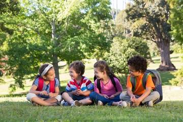 School children sitting on grass