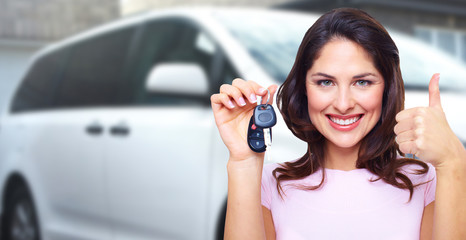 Woman holding car key.