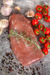 Fresh Raw meat with garlic on stone plate