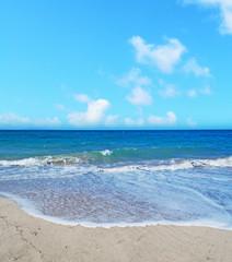 Platamona beach under a blue sky