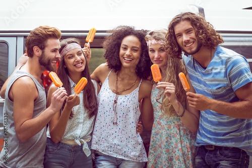 Hipster friends enjoying ice lollies - 78768330