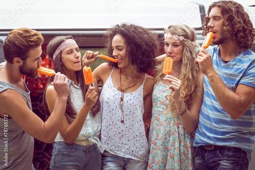 Hipster friends enjoying ice lollies - 78768372
