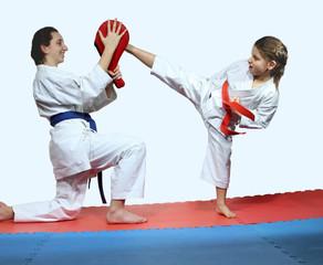 Little girl make kick mawashi geri jodan