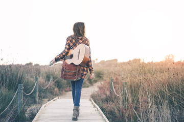 Beautiful Young Woman with guitar at Outdoors