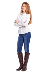 Young businesswoman in white shirt standing with crossed arms