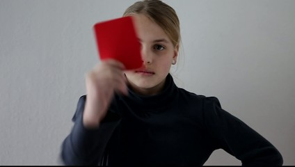 girl showing a red card