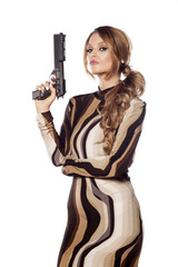 Beautiful young woman posing with a gun