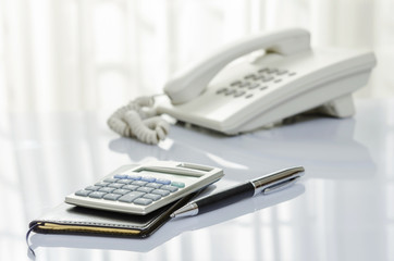 Calculator and personal book on telephone