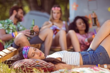 Happy hipsters relaxing on the campsite