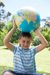 Little boy holding a globe
