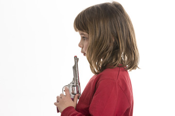 Little girl with a toy gun