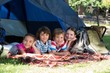 Happy siblings on a camping trip - 78770750