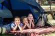 Happy siblings on a camping trip - 78770761