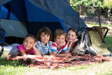 Happy siblings on a camping trip