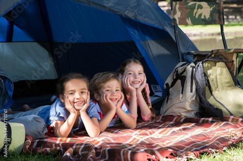 Fotobehang Kamperen Happy siblings on a camping trip