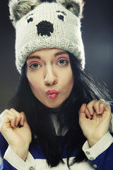 young woman in funny winter hat