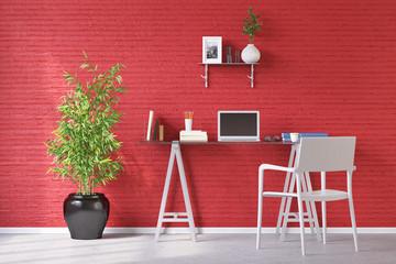 Schreibtisch mit Laptop vor roter Wand