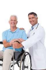 Doctor with senior patient in wheelchair