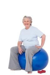 Senior woman sitting on exercise ball