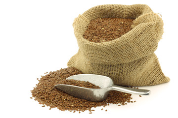 Flax seed (linseed) in a burlap bag on a white background