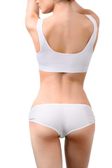 Woman with perfect slim body in white underwear isolated on