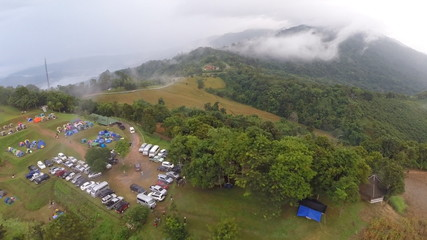 Aerial View: Flying over the forest in a fog