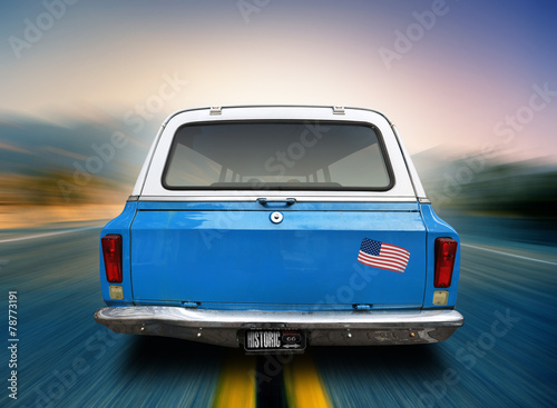 Blue car is moving along the American highway