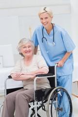 Female nurse pushing senior patient in wheelchair