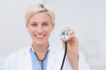 Smiling female doctor holding stethoscope