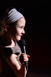 Little girl singing on the microphone