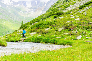 Young woman on a mountain trail, Zillertal Alps, Austria