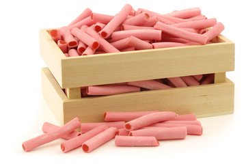 pink candy sticks filled with strawberry jam in a wooden box