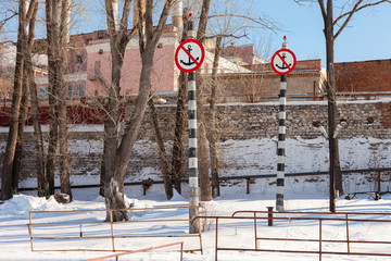 """Prohibition sign """"Anchors do not drop"""" on the bank of river"""
