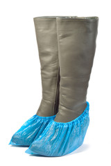 Women's leather boots in shoe covers.