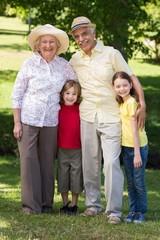 Happy grandparents with their grandchildren at the garden