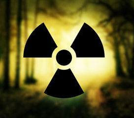Radioactivity symbol with glowing forest