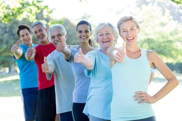 Happy athletic group with thumbs up