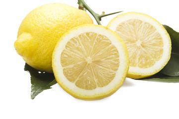 Lemon and lemon sliced close up on the white