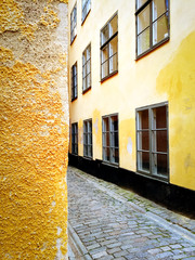 Bright yellow buildings in the old center of Stockholm