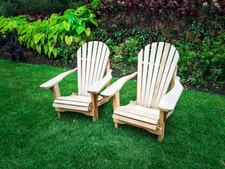 Wooden chairs on green lawn