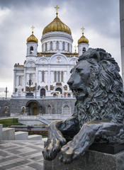 Russia, Moscow, russian church and a bronze lion sculpture