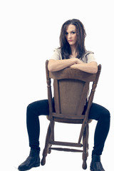 Portrait of a beauty lady on vintage chair isolated