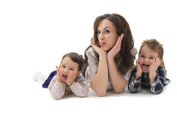 Young mother with two children having fun on a white background
