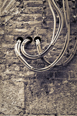 Electrical cables fixed on the wall