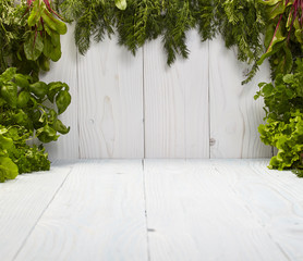 Green frame on white boards made from herbs