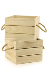 wooden crates with rope handles on a white background
