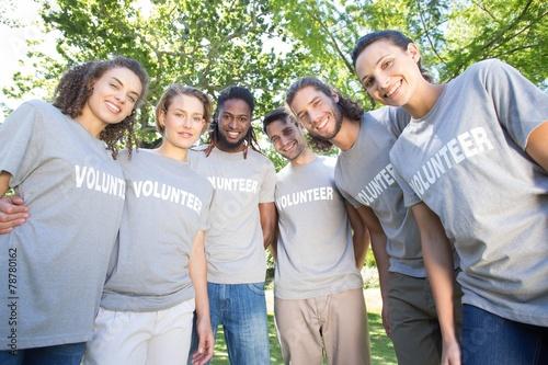 Happy volunteers in the park - 78780162