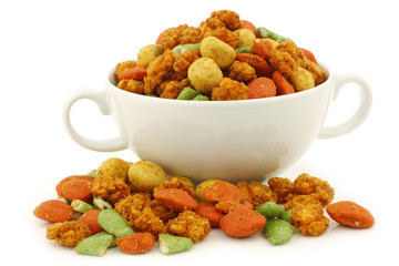 assorted colorfuI flavored nuts in a ceramic bowl