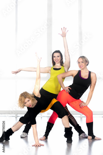 Staande foto Dance School Group of cheerful modern dancer females